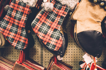 Christmas stockings hanging on store shelves