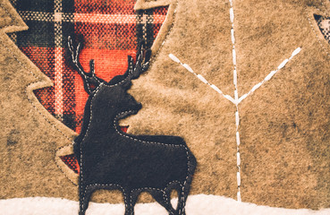 Stitched fabric reindeer Christmas background