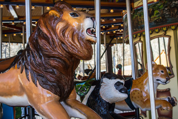 lion on a merry-go-round with a monkey and tiger