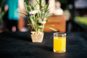 Orange juice in a glass cup on table in a restaurant.