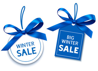 Winter sale tag with blue bow for your design. Vector set of discount labels