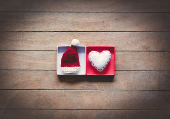 Santa Claus hat and heart shape toy in boxes
