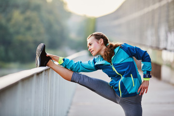 Picture of woman stretching legs before running