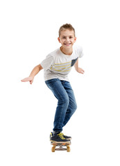 Happy smiling boy riding a skateboard