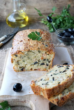 Cake with ham, olives, cheese and parsley