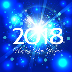 Beautiful blue fireworks with  greetings Happy New Year 2018!
