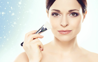 Face of attractive and healthy woman over winter Christmas background. Healthcare, spa, makeup and face lifting concept.