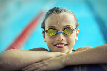 Swimmer child. Portrait of swimming child athlete with goggles a