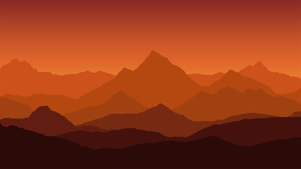panoramic view of the mountain landscape with fog in the valley below with the alpenglow orange sky and rising sun
