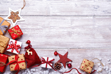 Christmas  gifts decoration background  -  Flat lay on old wood