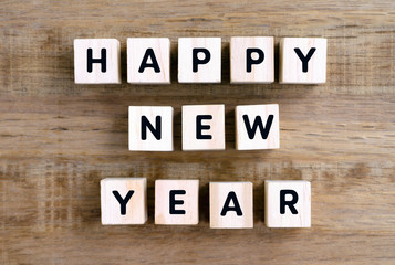 Happy New Year word on wooden block, retro style.