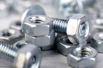 Metal nuts and bolts background. Macro. Working tools. Fixing elements.