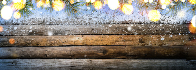 Christmas or New Year snowy vintage wooden table with fir tree