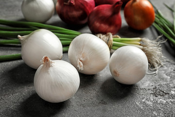 Fresh onions on grey background