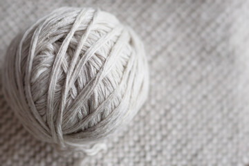 ball of threads on a knitted background close-up. knitting, space for text,