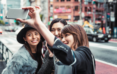 Group of japanese women spending time in Tokyo, making shopping in differents areas of the city