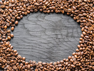 Roasted coffee beans arranged as a frame. Top view.