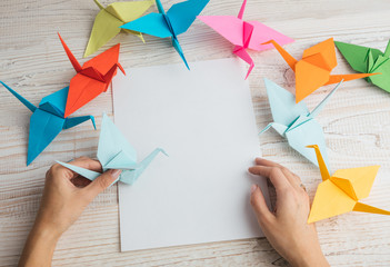 Japanese origami art of folding paper figures. Empty white paper for you text. Mockup template