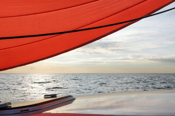 red sail the sea