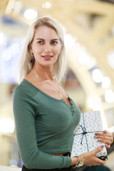 Image of long-haired blonde with gift box
