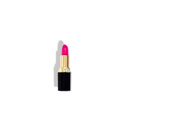Pink lipstick isolated on white background .