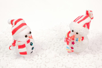 Snowmen in winter setting,