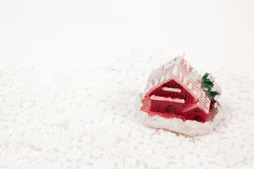 Christmas red house on snowflakes background.