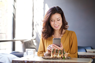 young food blogger make a picture with smart phone