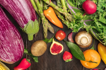 Overhead photo of vibrant fresh vegetables and fruit with copy space