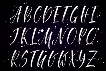 Brush handwritten vector alphabet with blobs on black background. Modern calligraphy, uppercase letters. Vector illustration.