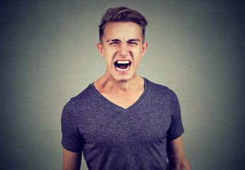 portrait of a young angry man screaming