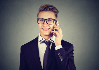 Handsome modern businessman calling on mobile phone