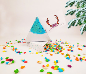 Christmas decoration triangle git box with candies for celebration best Christmas holidays background image for invitation