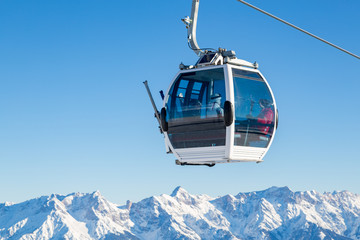 Cable car in ski area in the alps Wall mural