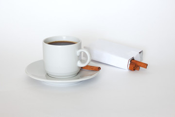 Coffee and cinnamon on white background .