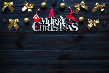 Christmas holidays composition on dark wooden background, free space for text