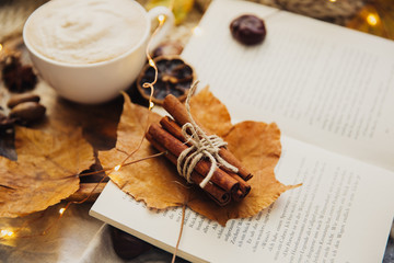 Autumn Cozy fall background with hot coffee cup and decorations. Hipster blogger morning