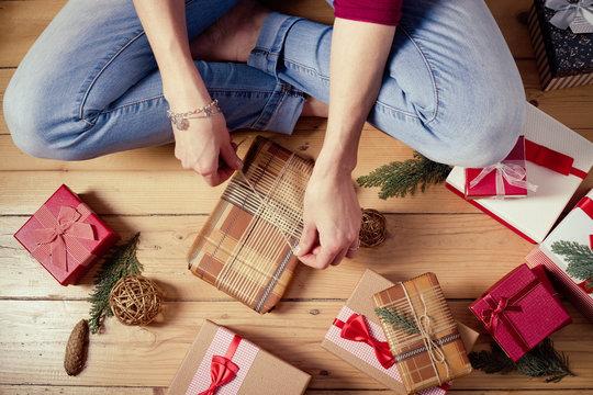 woman wrapping christmas presents