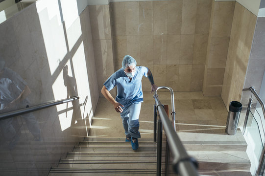 Man walking up stairs in hospital