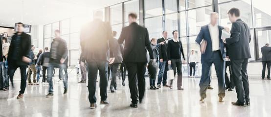 People visit a trade show, humans unrecognizable, business concept image