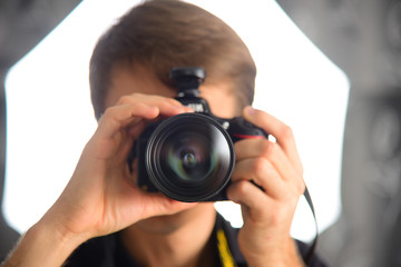 Man photographer journalist reporter operator selfie in mirror. Camera photo shot.
