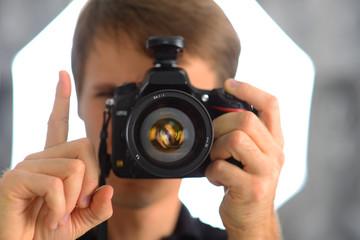 Hand finger gestures. Man photographer journalist reporter operator selfie in mirror. Camera photo shot.
