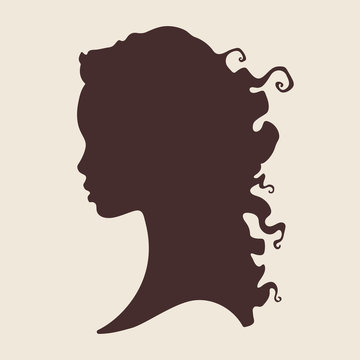 Silhouette of beautiful curly african woman in profile isolated vector illustration. Beauty salon or hair product logo design