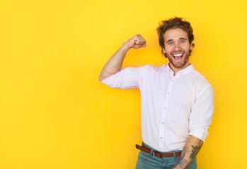 Cheerful man showing bicep Wall mural