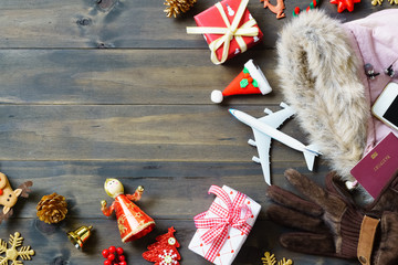 Christmas travel concept. Accessory women to travel Christmas and Happy new year concept background. Top view shot of sign winter season holidays trip.