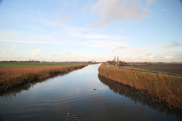 River named Rotte reflecting blue sky in Moerkapelle, Netherlands