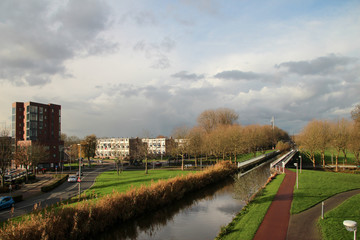 Ring canal of the Zuidplaspolder in the middle of village Nieuwerkerk aan den IJssel, Netherlands