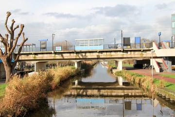 Station above the ring canal of the Zuidplaspolder in the middle of village Nieuwerkerk aan den IJssel, Netherlands