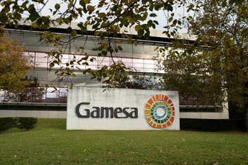 Workers from Siemens Gamesa protest job cuts outside the renewable