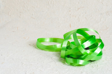 Abstract heap of green color ribbon stripe on textured paper background